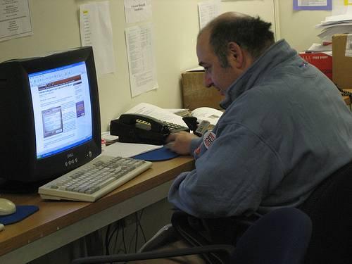 Old man using PC